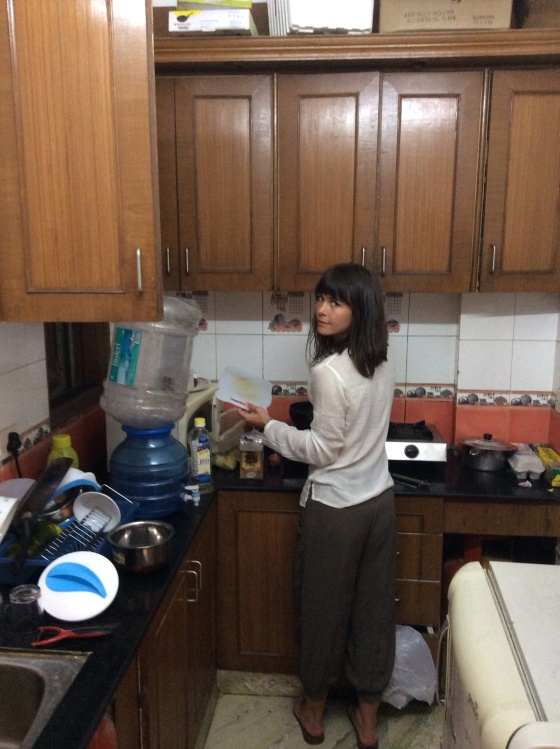 Me dabbling in a friend's kitchen in Delhi, grabbing the chance to be the chef and try my hand at a curry.